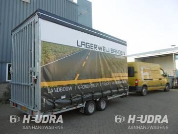 Maatwerk gesloten aanhangwagen met huifopbouw